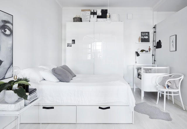 Monochrome-Scandinavian-bedroom-with-a-nursery-corner